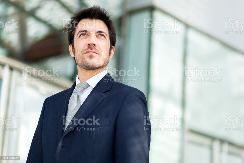 Portrait of a businessman looking into the distance stock photo
