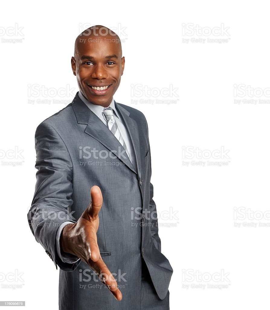 Portrait of a businessman reaching his hand for handshake royalty-free stock photo