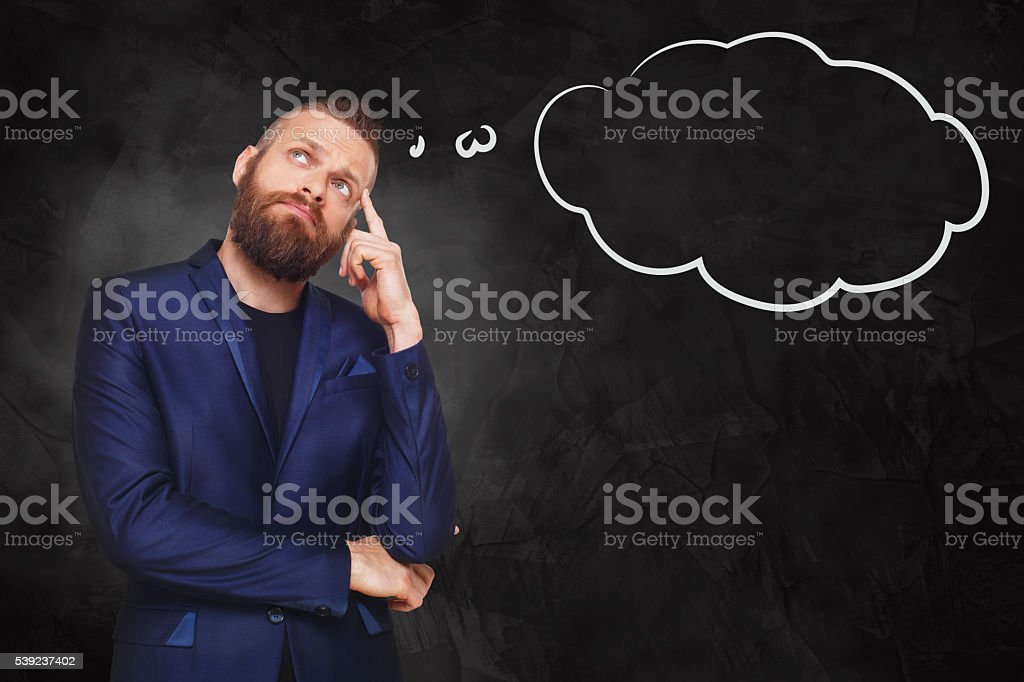 Portrait of a businessman with thinking cloud royalty-free stock photo