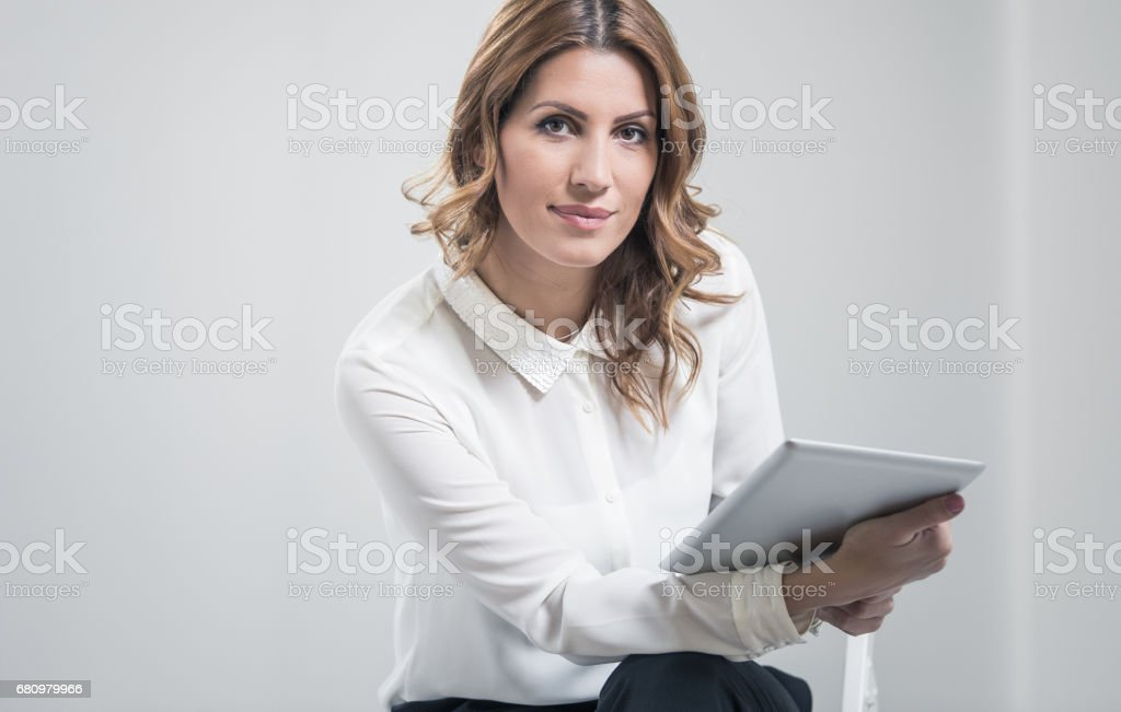 Portrait of a Businesswoman Holding a Digital Tablet royalty-free stock photo