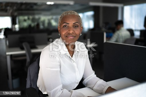 istock Portrait of a businesswoman in the office 1264290292
