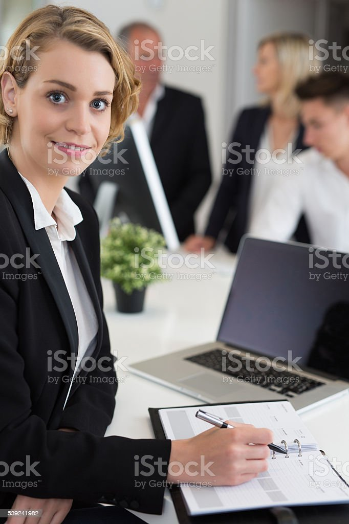 Portrait of a businesswoman using laptop in office royalty-free stock photo