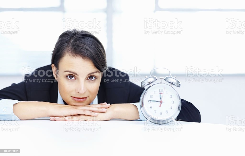 Portrait of a businesswoman with alarm clock royalty-free stock photo