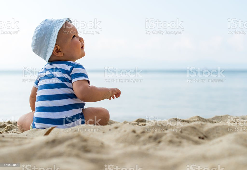 Portrait of a caucasian baby boy with a hat stock photo