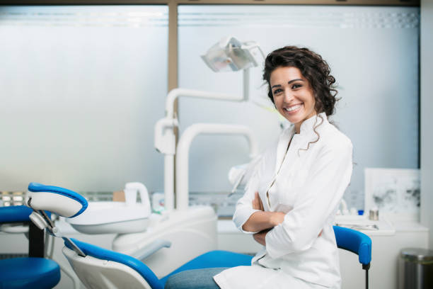 Portrait of a Caucasian female dentist in her office stock photo