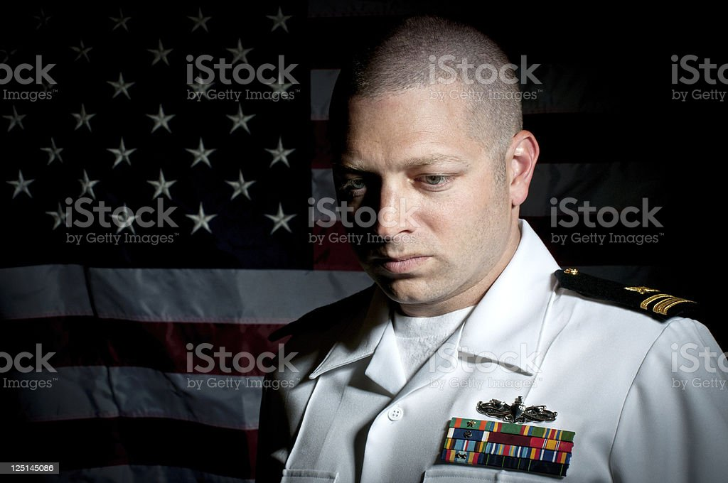 Portrait of A Caucasian Naval Officer with American Flag royalty-free stock photo