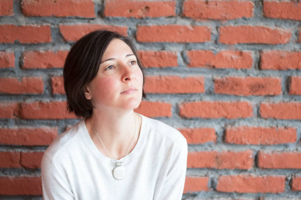 Portrait of a Caucasian woman with healthy pink cheeks and short brown hair stock photo