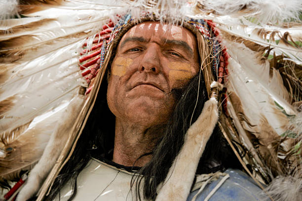 A portrait of a charismatic Native American chief Indian Chief,  indigenous peoples of the americas stock pictures, royalty-free photos & images