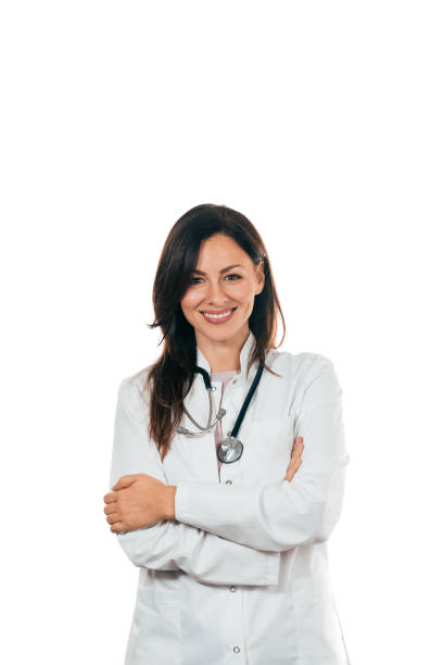 Portrait of a charming doctor with arms crossed. Copy space. stock photo