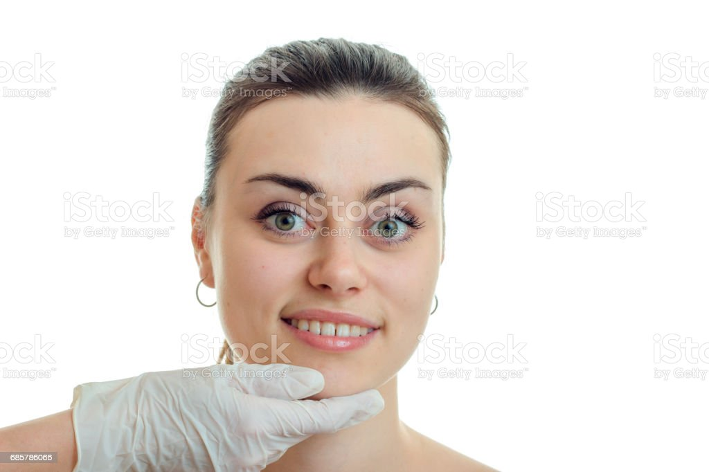 Portrait of a charming young girl without makeup at the beautician which looks into the camera and smiling royalty-free stock photo