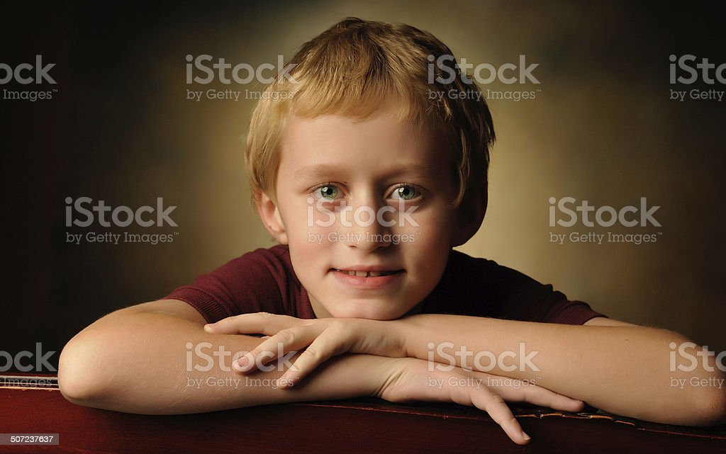 Portrait of a cheerful 10 year old boy stock photo