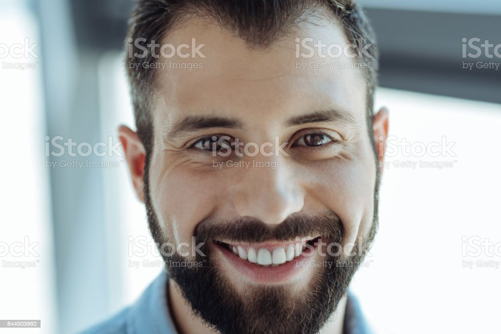 Portrait of a cheerful bearded man smiling stock photo