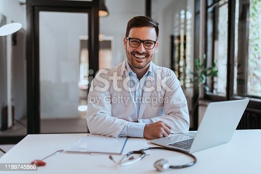 Portrait of a cheerful doctor in modern office.