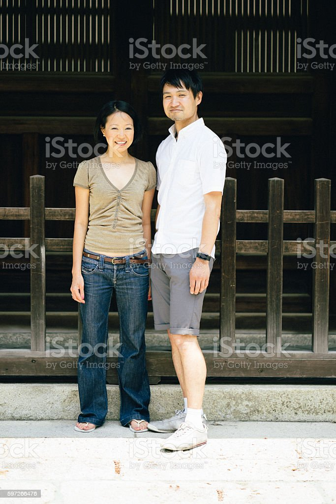 Portrait of a cheerful Japanese couple outdoors royalty-free stock photo