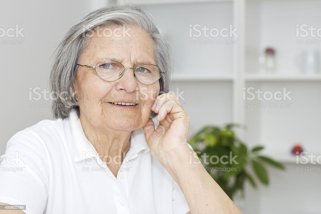 Portrait of a cheerful senior woman wearing white stock photo
