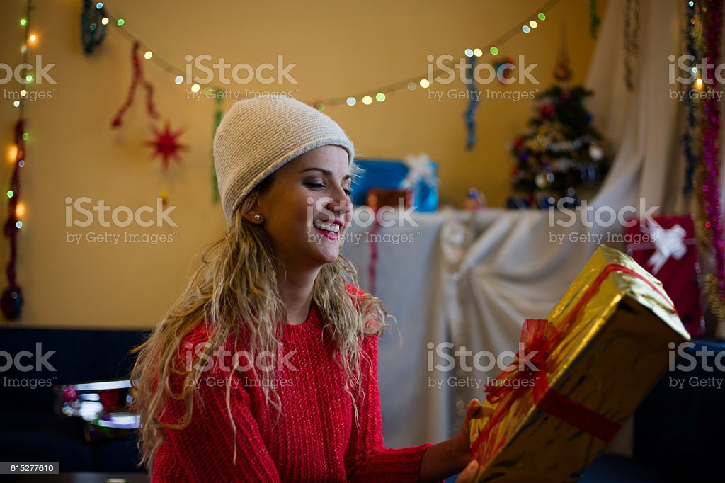 Portrait of a cheerful woman with gift box. stock photo