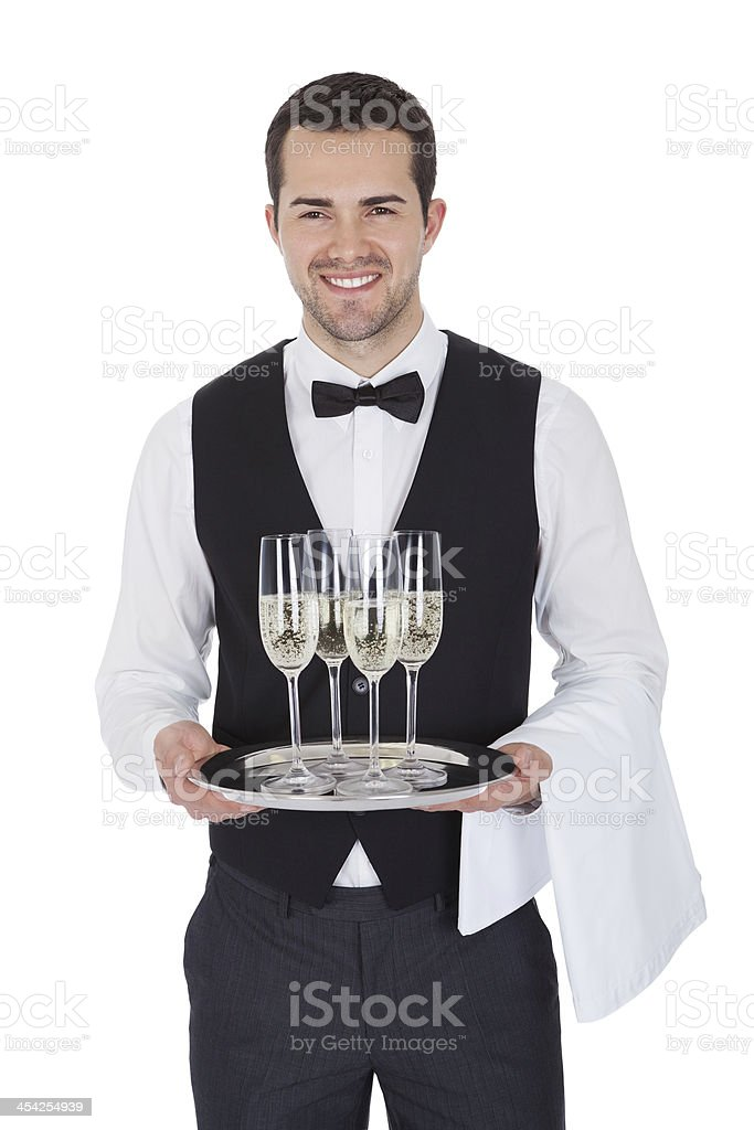 Portrait of a cheerful young butler royalty-free stock photo