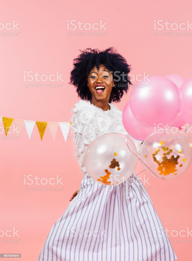 Portrait of a cheerful young girl with balloons stock photo
