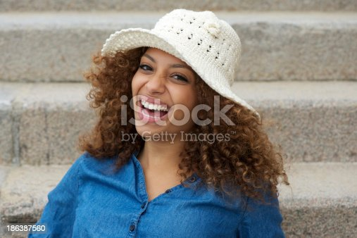 186534921 istock photo Portrait of a cheerful young lady laughing 186387560