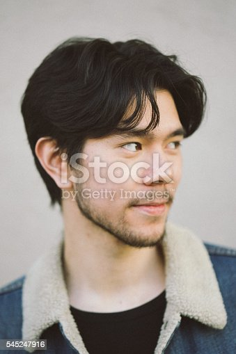 Close up portrait of a smiling young man with beard