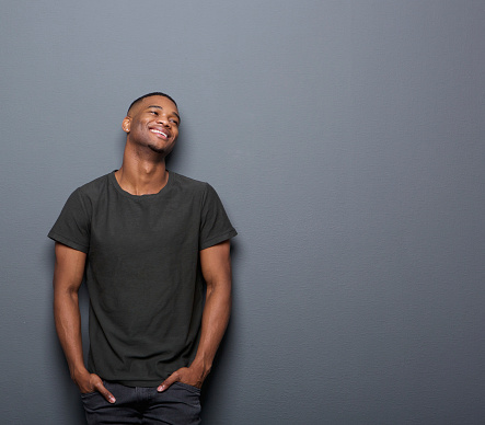 istock Portrait of a cheerful young man smiling 523415383