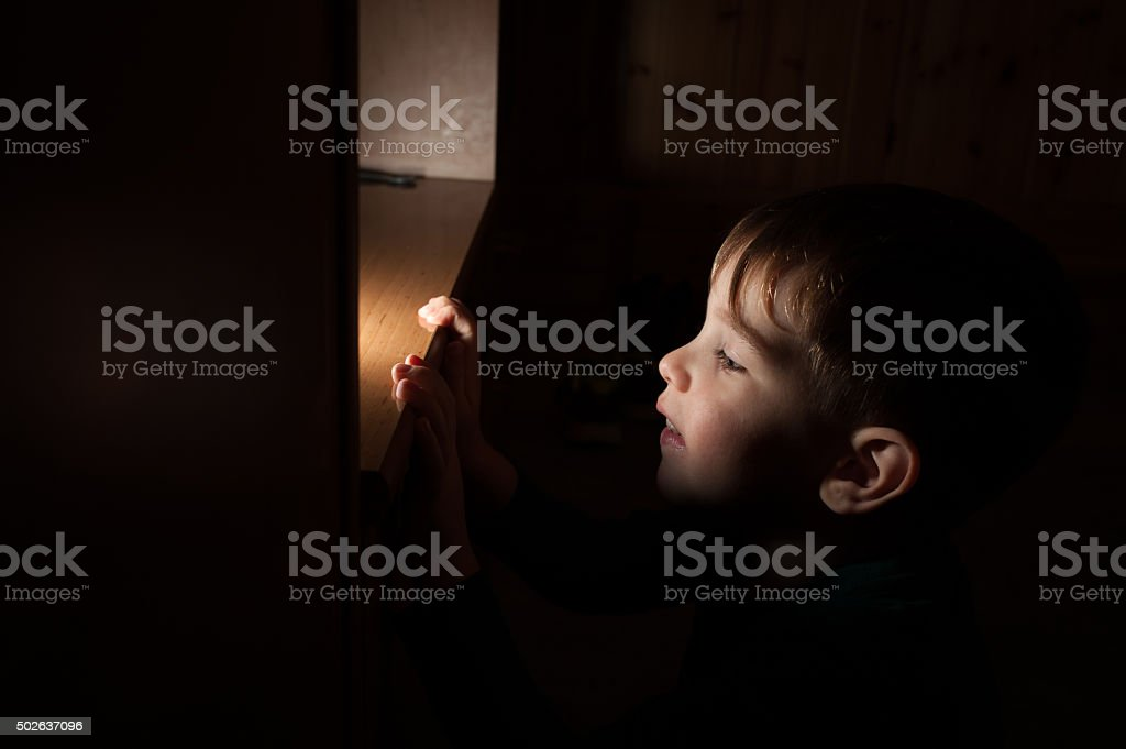 Portrait of a Child Lying by Night royalty-free stock photo