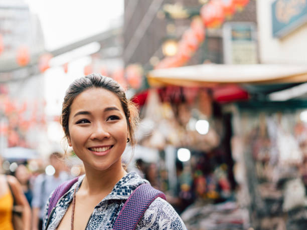 Portrait of a chinese young adult woman in Chinatown stock photo
