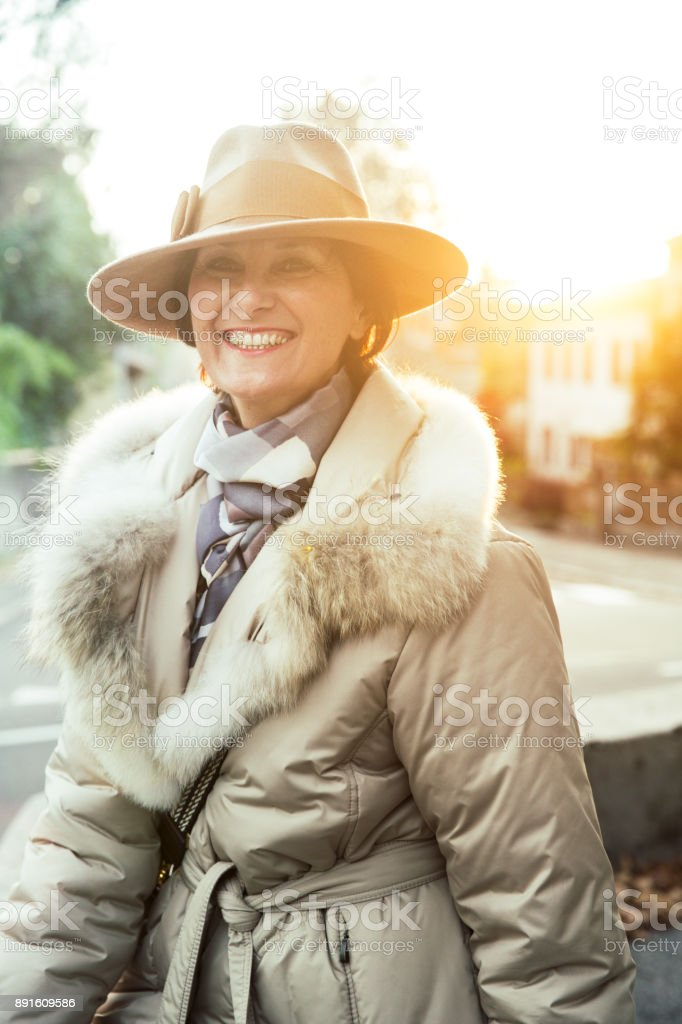 Portrait of a Classy Mature Woman Outdoors royalty-free stock photo