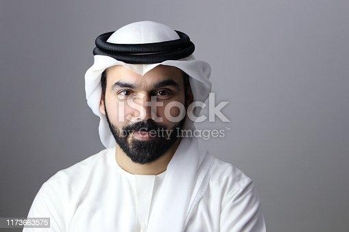 istock Portrait Of A Confident Arab Businessman Wearing UAE Emirati Traditional Dress 1173663575