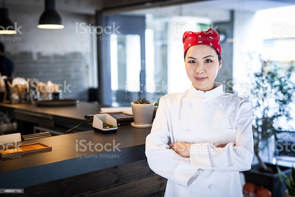 Portrait of a Confident Asian Cuisinier at a Restaurant stock photo