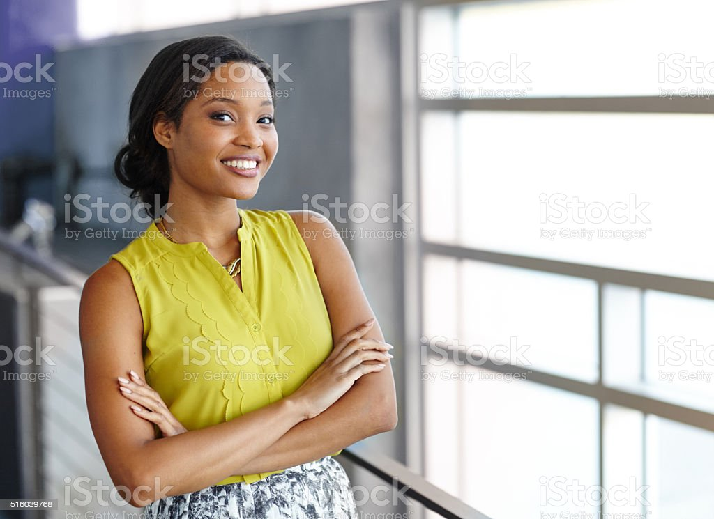 Portrait of a confident black businesswoman at work in her stock photo