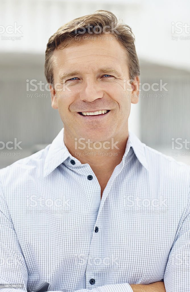 Portrait of a confident business man smiling royalty-free stock photo