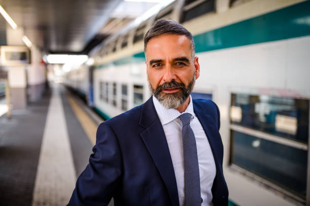 portrait of a confident businessman. - milan railway foto e immagini stock