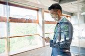 istock Portrait of a confident businessman using a smartphone 1028092788