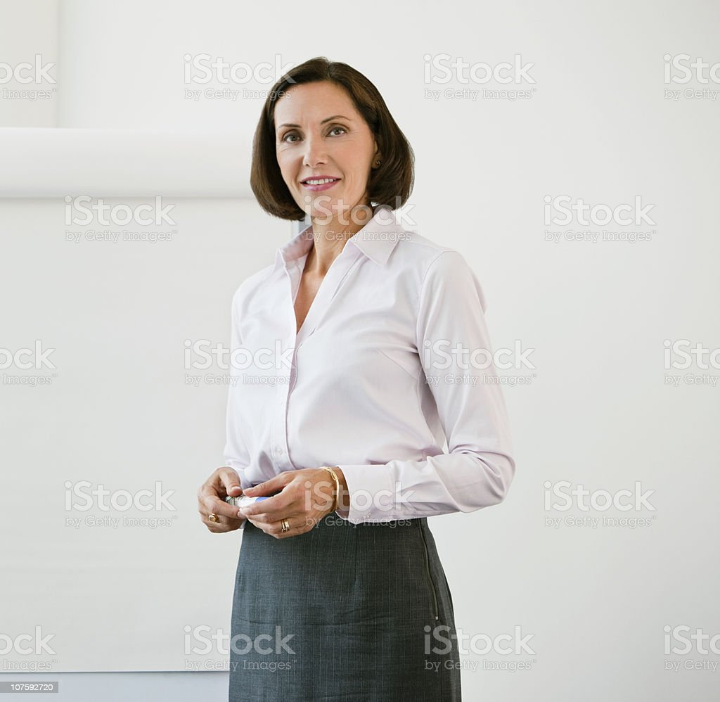 Portrait of a confident businesswoman in conference room stock photo
