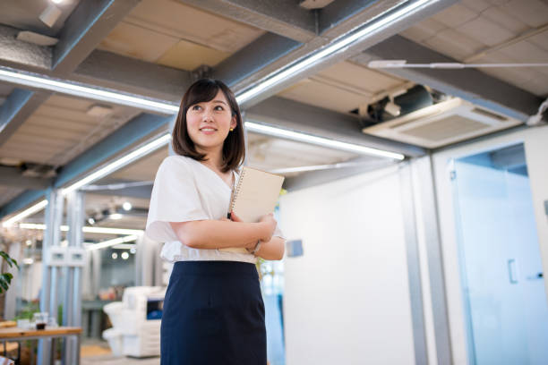 Portrait of a confident businesswoman Portrait of a confident businesswoman only japanese stock pictures, royalty-free photos & images