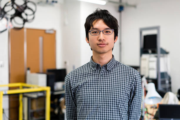 Portrait of a confident Engineering student Portrait of a Robotics student. Kyoto, Japan. May 2016 nerd stock pictures, royalty-free photos & images