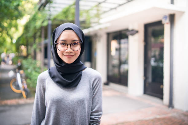 Portrait of a confident Muslim girl Portrait of a Malaysian girl looking at camera. headscarf stock pictures, royalty-free photos & images
