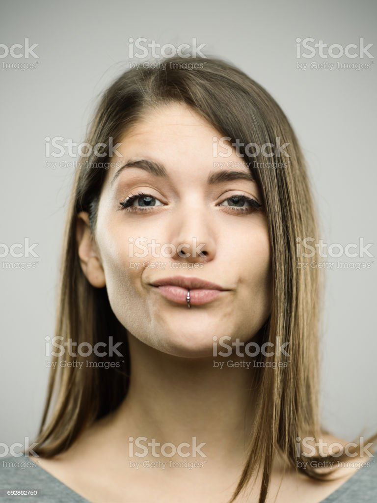 Portrait of a confident real young woman stock photo