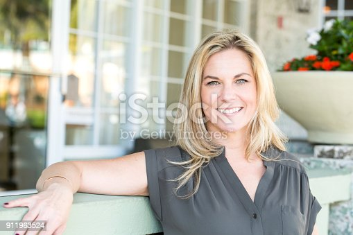 825083304 istock photo Portrait of a confident woman smiling. 911963524