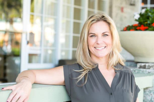 Portrait of a confident woman smiling. stock photo