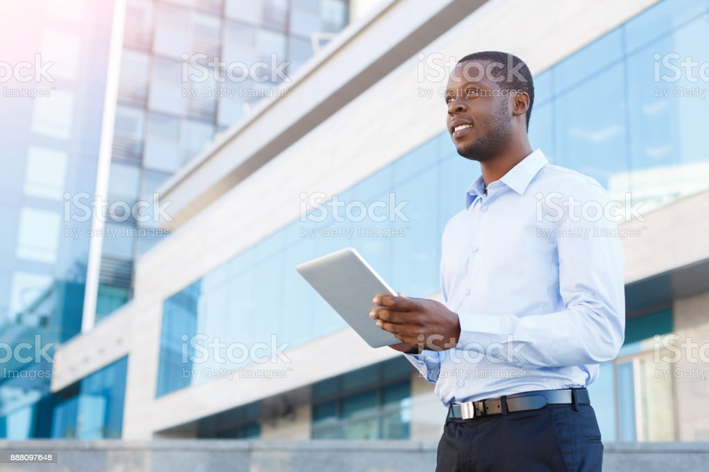 Portrait of a confident young black businessman with tablet stock photo