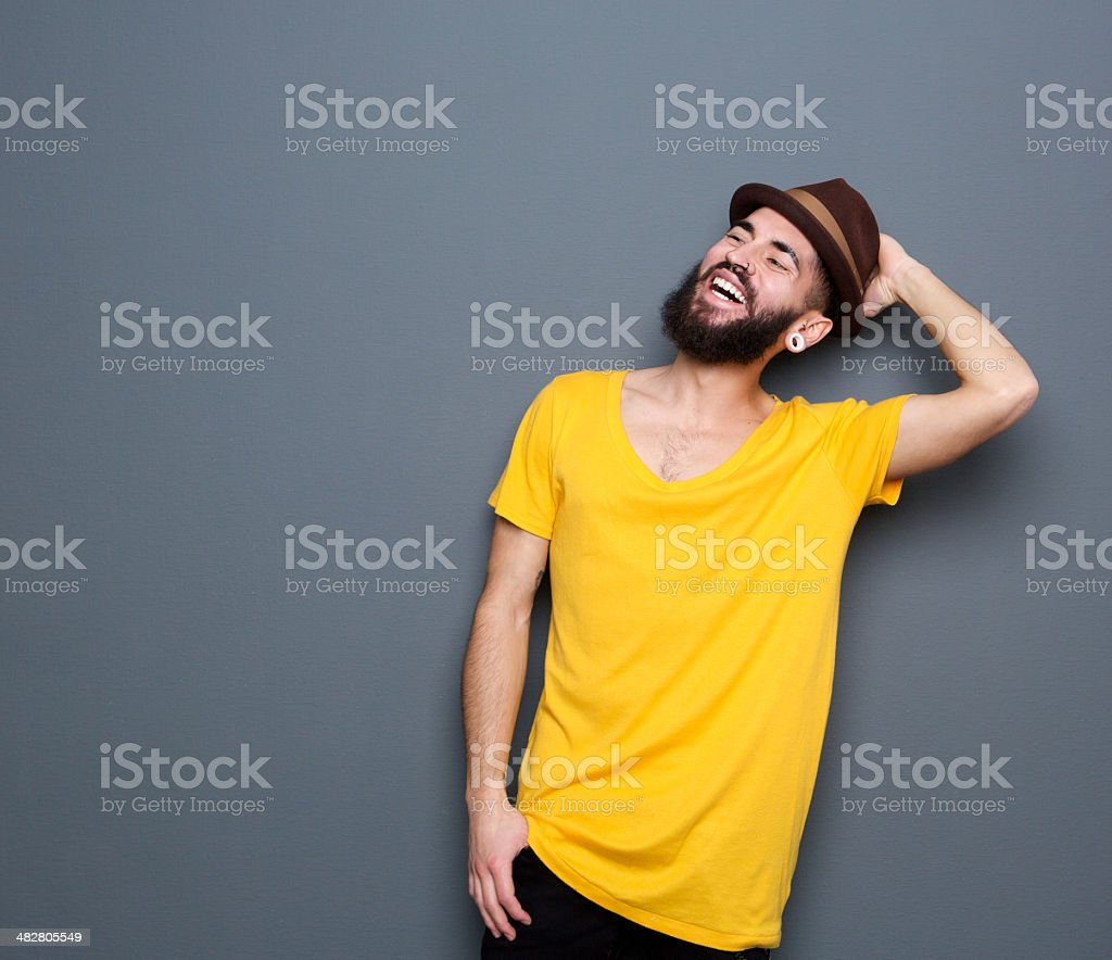 Portrait of a confident young man with beard smiling stock photo