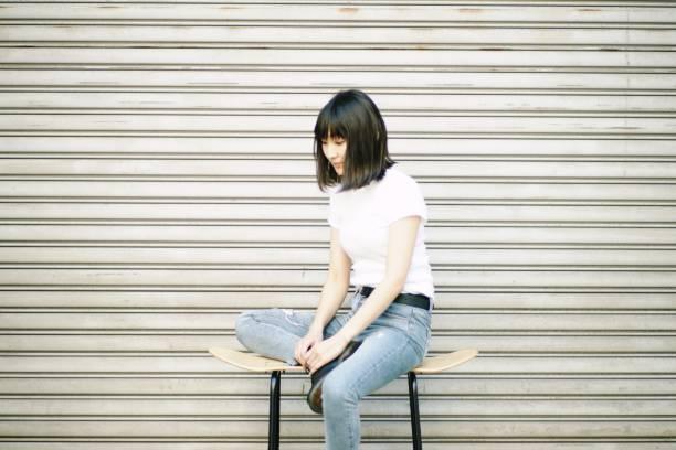 Portrait of a confident young woman Portrait of a confident young woman in Japan medium length hair stock pictures, royalty-free photos & images