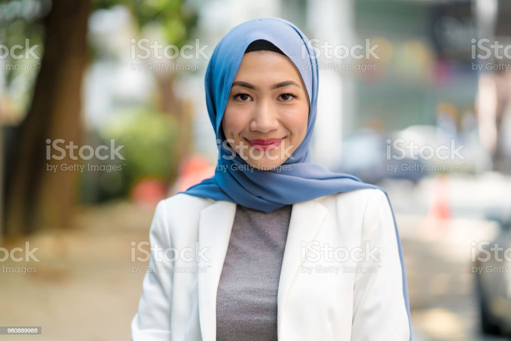 Portrait of a confident young woman wearing a hijab stock photo