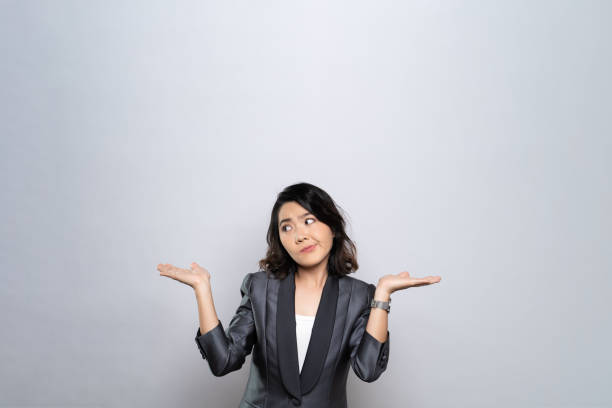 Portrait of a confused woman isolated over white background stock photo