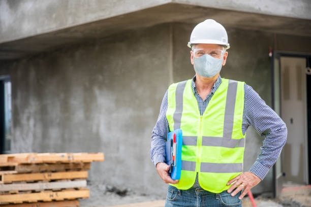 Portrait of a Construction Manager Wearing a Mask stock photo