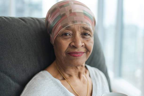 Portrait of a contemplative senior woman with cancer stock photo