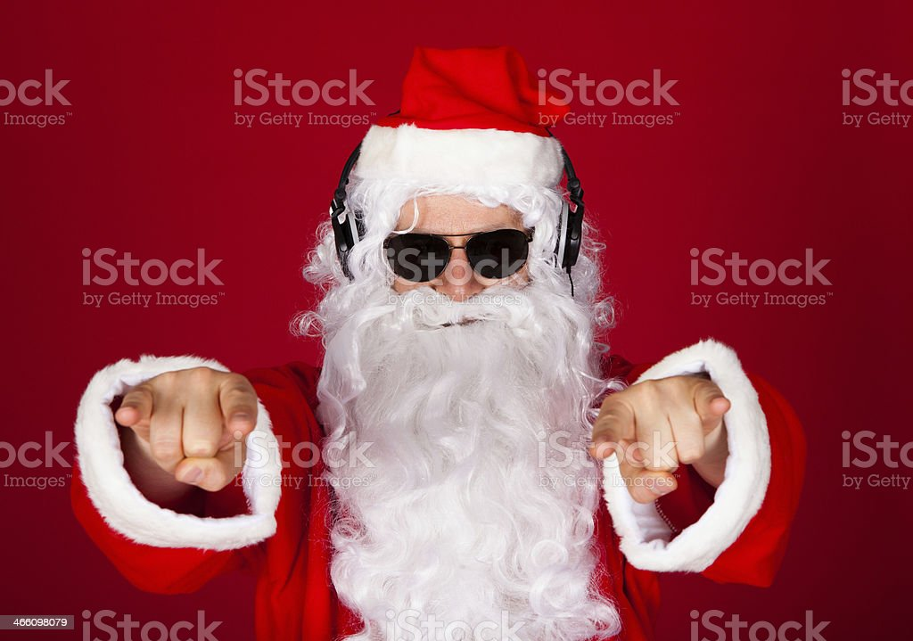 A portrait of a contemporary Santa Claus listening to music stock photo