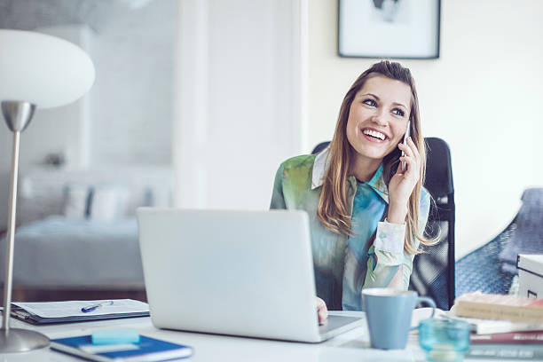 portrait of a content, smiling young woman - business woman phone stockfoto's en -beelden